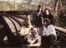 First page of John Anderson, Steve Marsden, Raymond Mungo, John Wilton, Chuck Light, Michael             Curry (clockwise from left), on railroad tracks near Montague Farm Commune