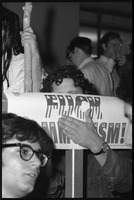 First page of Paul Krassner hiding behind a sign reading 'Fuck Communism'