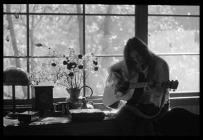 First page of Judy Collins playing guitar while silhouetted against a window in Joni Mitchell's house in Laurel Canyon