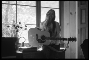 First page of Judy Collins seated in a window at Joni Mitchell's house in Laurel Canyon,             playing guitar