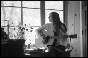 First page of Judy Collins seated in a window, playing guitar in Joni Mitchell's house in Laurel Canyon