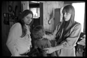 First page of Joni Mitchell (right) and Judy Collins, playing with a Graham Nash doll at Mitchell's house in Laurel Canyon