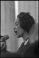 First page of Coretta Scott King addressing the Solidarity Day crowd at the Poor People's             March on Washington, speaking against the War in Vietnam Portrait in profile, at the microphones