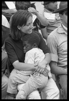 First page of White woman in the Solidarity Day crowd at the Poor People's March on             Washington, hugging an African American child while Coretta Scott King speaks