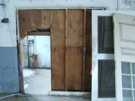 First page of Interior view through makeshift doorway Upper floor of the Cow Barn: Brooks Barn Complex, UMass Amherst