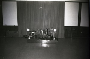 First page of The  Maze at a dance in the Student Union Ballroom Standing on stage before the performance