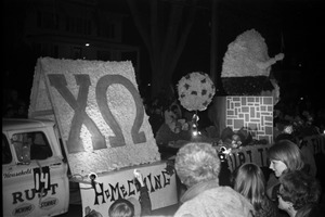 First page of Homecoming Parade (versus the University of Rhode Island) URI takes a fall: Chi Omega sorority float