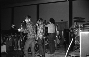 First page of SENDOFF event (Student Union Ballroom) The Turtles from the back: band from rear stage, including Al Nichol, Howard             Kaylan, Flo Volman, and Jim Pons ( l. to r.)