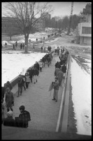 First page of Demonstration against Dow Chemical Co. and the war in Vietnam outside Whitmore             Hall, UMass Amherst Protesters lining the ramp to the entrance to Whitmore Hall, Herter Hall             (under construction) in background