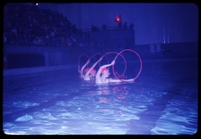 First page of Naiads aquatic show, 'Circles', UMass Amherst L. to r.: Jane Pentland, Sandra Switzer, and Susan Paterson