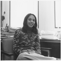 First page of Bernadette Anita Nelson Shapiro seated in her office