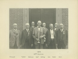 First page of Eight members of the class of 1876 standing in front of Memorial Hall holding a             trophy