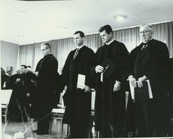 First page of President John W. Lederle, Governor Endicott Peabody, Senator Edward Kennedy, and James T. Nicholson standing at Charter Day convocation