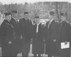 First page of Charter Day: James Pollack, Charles Avila, Glenn Seaborg, George Meany, Governor Endicott Peabody, and President John W. Lederle outside Totman Gymnasium