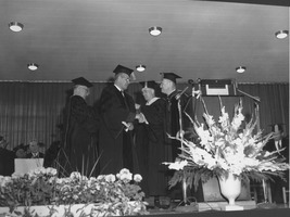 First page of Charles Avila at his hooding ceremony during the Centennial Charter Day convocation