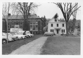 First page of Demolition of the Mathematics Building near Fernald Hall; view from the front with       Insectary gone and Volkswagen microbus parked in front