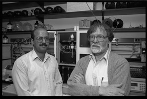 First page of Louis Carpino (right) and unidentified colleague in the lab