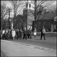 First page of Memorial march for Martin Luther King., Jr., led by Linus Pauling Man with sign reading 'In memoriam Martin Luther King April 4, 1968' leading             marchers past the MercyHouse (Baptist Church) on North Pleasant Street, Pauling in front