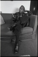 First page of James Baldwin Baldwin seated on a sofa, leaning back