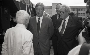 First page of Ceremonial groundbreaking for the Conte Center: Richard Stein chatting with Gov.             William Weld and Provost Richard O'Brien (l. to r.)