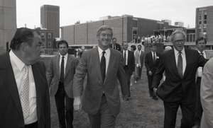 First page of Ceremonial groundbreaking for the Conte Center: Gov. William Weld walking to the             site of groundbreaking, Provost Richard O'Brien to his left