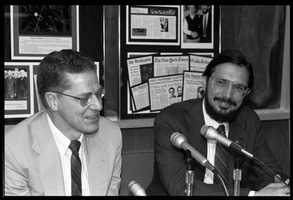 First page of Russell A. Hulse (right) and Joseph H. Taylor: seated at a microphone at a press conference at UMass             Amherst following receipt of the Nobel Prize in Physics