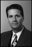 First page of John Calipari: studio portrait of coach of UMass Amherst basketball team