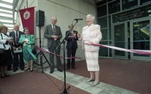 First page of Dedication ceremonies for the Conte Polymer Center: Corinne Conte cutting the             ribbon