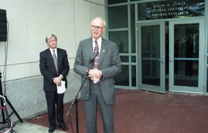 First page of Dedication ceremonies for the Conte Polymer Center: John Olver addressing the             crowd, David K. Scott in background