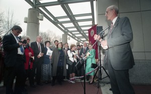 First page of Dedication ceremonies for the Conte Polymer Center: John Olver addressing the             crowd (view toward the crowd)