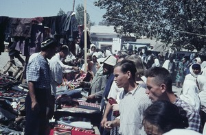 Thumbnail of Men's clothing seller at a market