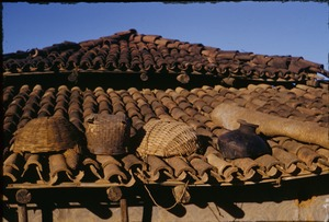 Thumbnail of Baskets and a broken pot on the roof