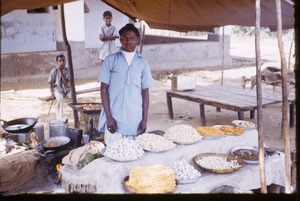 Thumbnail of Seller of sweets at a market in Mangadu
