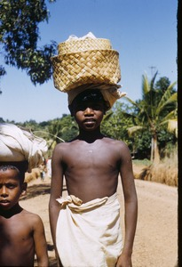 Thumbnail of Two boys carry things on their heads