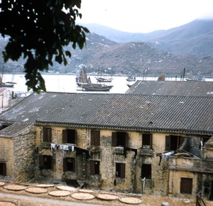 Thumbnail of Roofs, boats and mountains