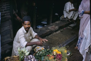 Thumbnail of A flower seller on market day