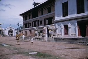 Thumbnail of People walking past the Lion Gate