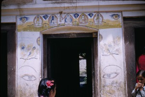 Thumbnail of Girls at a temple entrance