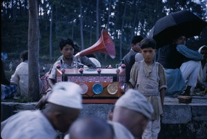 Thumbnail of Boys playing a decorated phonograph