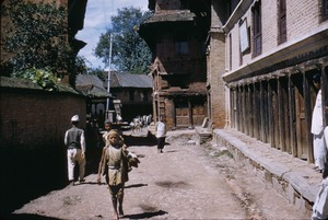Thumbnail of Boy walking down street in Patan