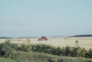 Thumbnail of Hay harvester in a field