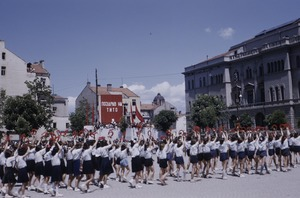 Thumbnail of Schoolchildren saluting at national celebration