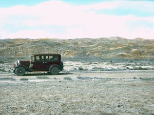 Thumbnail of Old red automobile in the desert