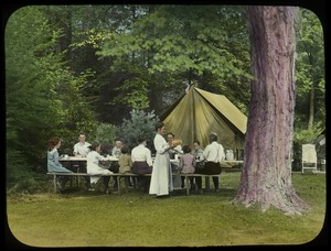 Thumbnail of Waugh family at a picnic table while camping