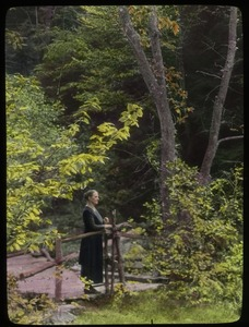 Thumbnail of Whately Glen: woman on wooden bridge in the woods