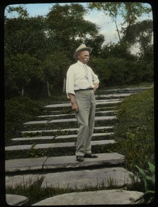 Thumbnail of Jens Jensen (man standing on wide steps with plants around)
