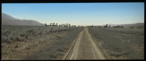 Thumbnail of Southern Utah town (dirt road, houses and trees in distance)