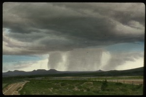 Thumbnail of Southern Utah (stormy skies raining over distant mountains, plains in foreground)