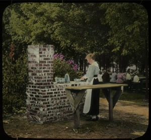 Thumbnail of Camp fireplace Topeka (woman cooking on brick stove)