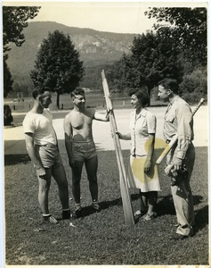 Thumbnail of Maida L. Riggs and armed service men holding oars